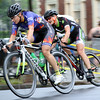 DAVID LE/Staff photo. Two racers in the Women's Elite race make a sharp turn onto Washington Square West during the annual Witches Cup on Wednesday evening. 8/10/16.