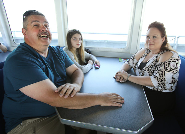 KEN YUSZKUS/Staff photo.  Tourists from Washington D.C., from left, Donald Cloutier, his daughter Janel, and wife Emily ride the  Salem Ferry from Boston to Salem.   08/03/16