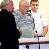 KEN YUSZKUS/Staff photo.         Douglas Steeves, center, is arraigned in Salem District Court for the murder of his wife.    08/02/16