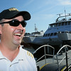KEN YUSZKUS/Staff photo.  Captain Steve Cleary of Wakefield is in front of the Nathaniel Bowditch, which is the Salem Ferry, docked in Boston.   08/03/16