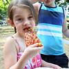 KEN YUSZKUS/Staff photo.   Finna Walsh, 4, and her brother Awley, 7, of Marblehead, take bites out of some slices of pizza during the Salem's Best Pizza competition held on the Salem Common.  08/08/16