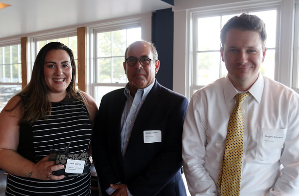 DAVID LE/Staff photo. Sarah Guarino, of Advance Reproductions Corporation, Bill Austin, of Marcum LLP, and Gregory Degraeve, of Merrill Lynch, at the North Shore Chamber of Commerce's networking event held at Sea Level in Salem on Thursday evening. 8/18/16.
