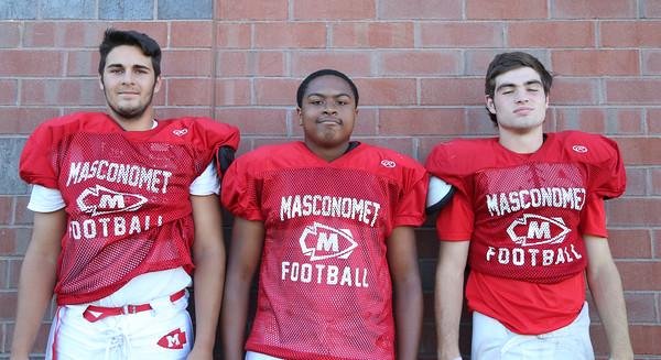 DAVID LE/Staff photo. Masco football junior Damon DiBurro, Josiah Evans, and Danny Monagle. 8/29/16.