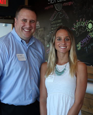 DAVID LE/Staff photo. Erik Smith and Rachel Maniates, of the North Shore Chamber of Commerce, at the North Shore Chamber of Commerce's networking event held at Sea Level in Salem on Thursday evening. 8/18/16.
