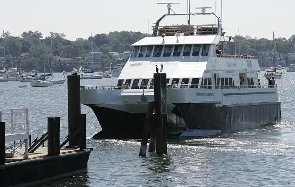 KEN YUSZKUS/Staff photo.  The Salem Ferry leaves Salem headed to Boston.   08/03/16