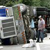 KEN YUSZKUS/Staff photo    Tractor trailer truck rollover on the ramp from Route 1 North onto Rte 95 North in Peabody.  08/16/16