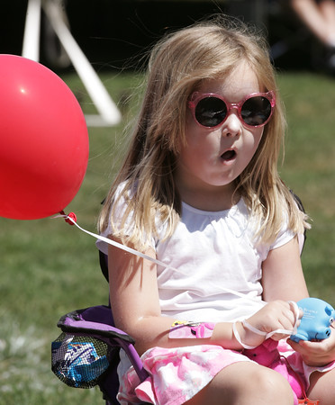 KEN YUSZKUS/Staff photo.    Elise Reed, 5, takes in the activities at the Lobster Festival held at Lynch Park.  08/03/16