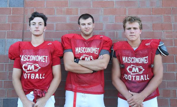 DAVID LE/Staff photo. Masco football junior Dash Crevoiserat, and seniors Liam Whelan and Will Hanson. 8/29/16.