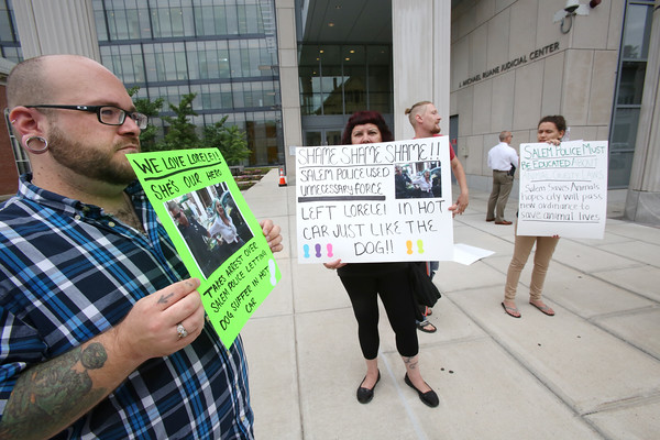 KEN YUSZKUS/Staff photo    Loreiei's supporters, Tim Reagan, left, and Cat DeLeon, center, protest with others outside of Salem District Court .  08/16/16