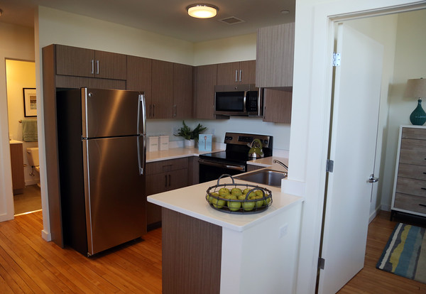 DAVID LE/Staff photo. A central kitchen sits in between the bathroom and master bedroom in a two-bedroom floor plan unit. 8/29/16.