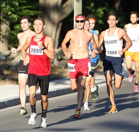 DAVID LE/Staff photo. Former Peabody standout Drew Fossa (2895) leads the pack at the start of the Beverly Homecoming Race. Fossa maintained his lead throughout the race, finishing first overall. 8/4/16.