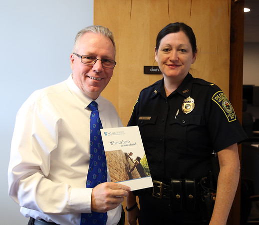 DAVID LE/Staff photo. Peabody Police Lieutenant Sheila McDaid, right, and Peabody Police Chief Tom Griffin. 8/2/16.