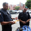 DAVID LE/Staff photo. Beverly Police Officer Mark Panjwani, left, explains the procedures for administering the department's Narcan kits to officer Chris Ganey, right. 8/11/16.
