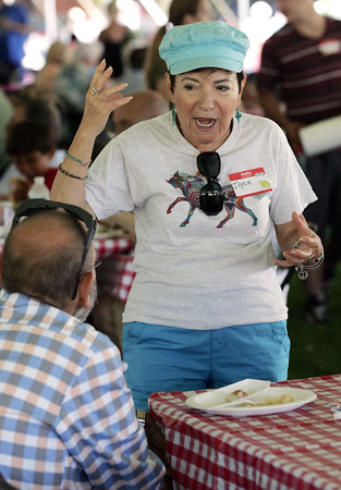 KEN YUSZKUS/Staff photo.    Joyce De Fazio speaks with Dan Clay at the Lobster Festival held at Lynch Park.  08/03/16