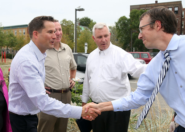 DAVID LE/Staff photo. Congressman Seth Moulton, left, shakes hands with Jeff Gentry, Director of Transitional Services for Triangle, right, after being introduced by Coleman Nee, center, CEO of Triangle, an organization that works with people with disabilities. 8/31/16.