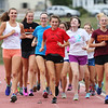 DAVID LE/Staff photo. Beverly High School senior cross country captains Abby Walsh, Nora Monahan, and Lexi Sutyak lead a couple warm up laps at practice on Wednesday. 8/31/16.