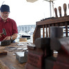DAVID LE/Staff photo. Geoffrey Blake, of Exeter, NH, demonstrates how to craft silverware by hand at the annual Salem Heritage Festival on Saturday. 8/7/16.