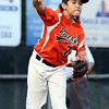 DAVID LE/Staff photo. Beverly third baseman Dom Santos fires across the diamond to nail a Lynn runner by a step. 8/17/16.