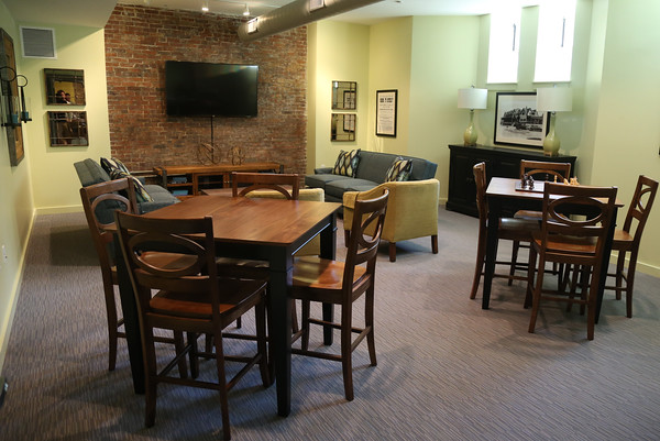 DAVID LE/Staff photo. The Club Room can be rented out for larger gatherings or for residents to take advantage of the big screen tv and cable. 8/29/16.