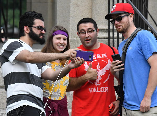 Pokemon hunters take a slefie with Gym leader Erika on the Salem Common, as part of the Pokemon Go event in Salem.<br /> <br /> Photo by JoeBrownPhotos.com