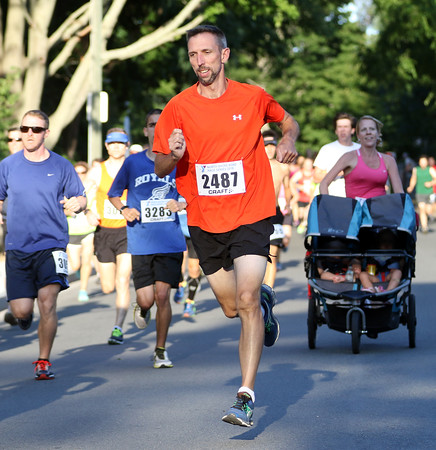 DAVID LE/Staff photo. Beverly's Sean Dunleavy races out to a fast start of the Beverly Homecoming race. 8/4/16.