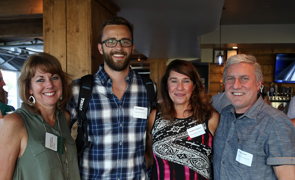DAVID LE/Staff photo. From left, Gia Page, of Davio's, Erik Hibbard, of Sperling Interactive, Heather Maurice, of Danversport Yacht Club, and Craig Grant, of Craig Grant Creative, at the North Shore Chamber of Commerce's networking event held at Sea Level in Salem on Thursday evening. 8/18/16.