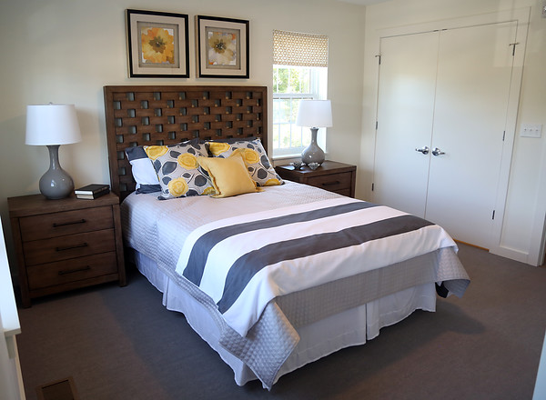 DAVID LE/Staff photo. The master bedroom in a one bedroom townhouse-style condo at the new apartment complex at the site of the old McKay School in Beverly. 8/29/16.