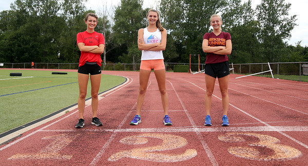 DAVID LE/Staff photo. Beverly High School senior cross country captains Nora Monahan, Abby Walsh, and Lexi Sutyak will lead the Panthers this fall. 8/31/16.