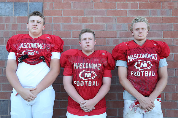DAVID LE/Staff photo. Masco football seniors Tom Yeakel, Wes Doucette, and Tommy Bennett. 8/29/16.