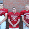 DAVID LE/Staff photo. Masco football seniors Tom Yeakel, Wes Doucette, and Tommy Bennett. 8/29/16.