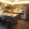 DAVID LE/Staff photo. The kitchen and breakfast bar is open to the living room area in one of the two-story townhouses. 8/29/16.