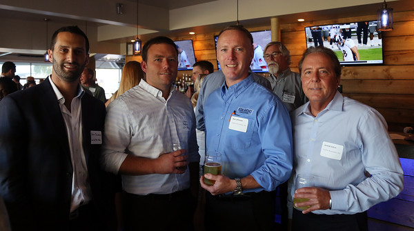 DAVID LE/Staff photo. From left, Steve Birenbaum, of Sound and Vision Media, Steve Rollins, of G.T. Reilly, Dan Johnson, of GraVoc Associates, and Arnold Atkin, also of GraVoc Associates, at the North Shore Chamber of Commerce's networking event held at Sea Level in Salem on Thursday evening. 8/18/16.