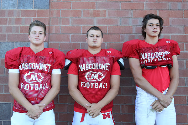 DAVID LE/Staff photo. Masco football seniors Jason Slattery, Tim Beliveau, and Josh Anderson. 8/29/16.