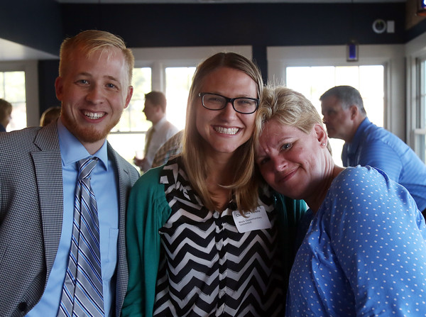 DAVID LE/Staff photo. Eric Scamman, of the North Shore Chamber of  Commerce, and Christina Doore and Melissa Nobles, of Work Opportunities Unlimited, at the North Shore Chamber of Commerce's networking event held at Sea Level in Salem on Thursday evening. 8/18/16.