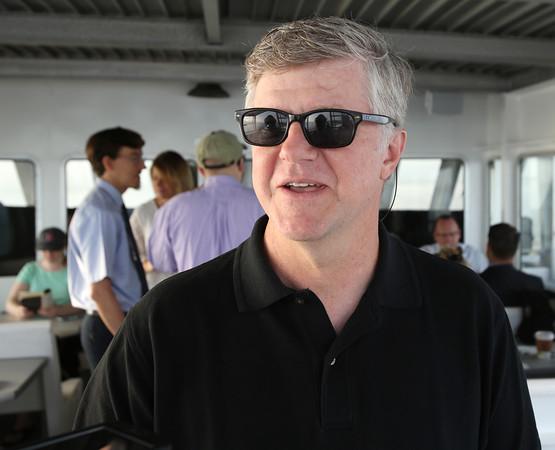 KEN YUSZKUS/Staff photo.  Stuart Cummings of Marblehead, speaks about his experiences on the Salem Ferry.   08/03/16