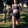 DAVID LE/Staff photo. Former Peabody High track and cross country star and rising Providence College senior Catarina Rocha, was the first woman to cross the finish line of the annual Beverly Homecoming Race on Thursday evening. 8/4/16.