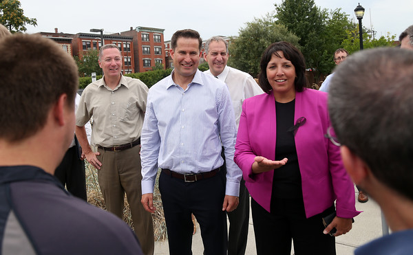 DAVID LE/Staff photo. State and local officials including State Reps Paul Tucker and Jerry Parisella, Congressman Moulton, second from left, and Salem Mayor Kim Driscoll paid a visit to the river walk in the Pointe neighborhood in Salem where workers from Triangle, an organization that helps individuals with disabilities find work, were cleaning up the walkway. 8/31/16.