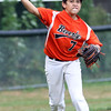 DAVID LE/Staff photo. Beverly third baseman Dom Santos fires across the diamond to record an out against Lynn. 8/16/16.