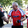 DAVID LE/Staff photo. Col. Gary West, center, warmly shakes hands with veterans agent Jim Schultz, left, while flanked by his wife, Collette, right, on a stop at the Swampscott Monument on his Patriots Honor Ride from Maine to Florida. 8/7/16.