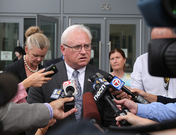 DAVID LE/Staff photo. Essex County District Attorney Jonathan Blodgett addresses the media while flanked by attorney Kate McDougal and current Peabody Police Chief Thomas Griffin following a change in plea from Kristen LaBrie, of Salem. 8/31/16.