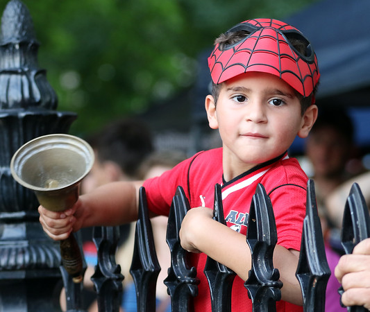 DAVID LE/Staff photo. Six-year-old Dave Silva, of Beverly, rings a bell during the annual Witches Cup on Wednesday evening. 8/10/16.