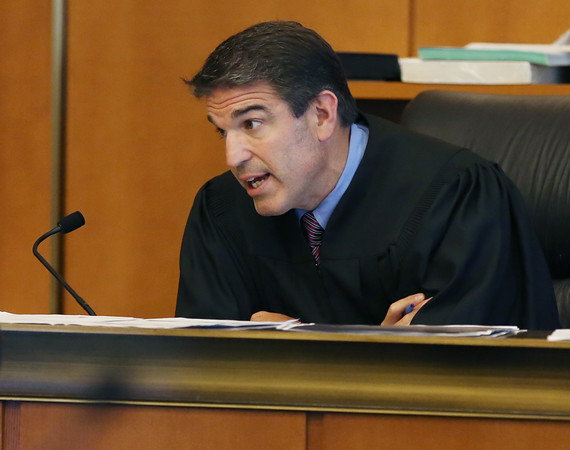 KEN YUSZKUS/Staff photo.    Salem District Court Judge Robert Brennan speaks during the arraignment of Henry Hernandez of Salem after his pit bulls attacked one of his neighbors and her Lab.    08/04/16