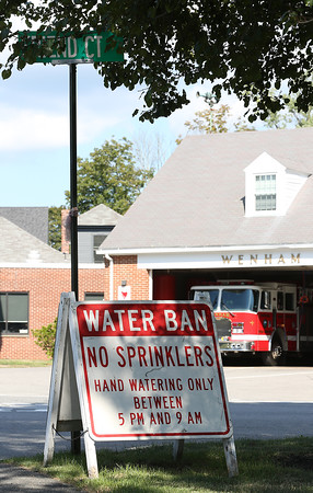 DAVID LE/Staff photo. The lack of rain has enforced a water ban for most of the summer. A sign is seen here near the Wenham Fire Department. 8/26/16.