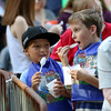 DAVID LE/Staff photo. Ten-year-olds Kalvin Wilson, left, and Kaiden Brewster, of Salem, sample their ice cream while waiting in line for more samples at the annual Ice Cream Bowl on Tuesday evening. 8/9/16.