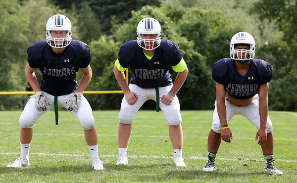 DAVID LE/Staff photo. Pingree starting linebackers include sophomores Vito Visconti and Grant Latimer, left, and senior captain Omar Badr, right. 8/25/16.