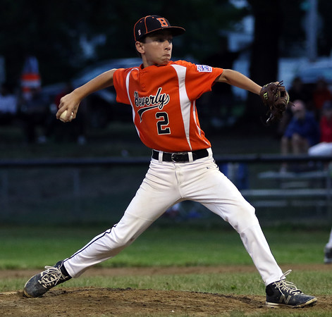 DAVID LE/Staff photo. Beverly relief pitcher Ryan Rushton delivers a pitch against Lynn. 8/16/16.