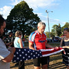 DAVID LE/Staff photo. Col. Gary West, center, instructs Matt and Beth MacDonald, how to properly fold a flag during a short ceremony on his Patriots Honor Ride from Maine to Florida. 8/7/16.