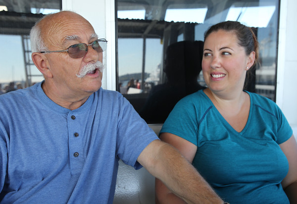 KEN YUSZKUS/Staff photo.  Tourists from Australia, David Linke and Danielle Linke, ride the  Salem Ferry from Boston to Salem.   08/03/16