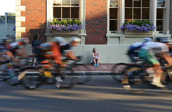 RYAN HUTTON/ Staff photo<br /> Kathleen Rainer, of Marblehead, watches one of the later laps of the men's professional race speed down South Washington Square during the 10th Annual Witches Cup bicycle race around Salem Common on Wednesday night.