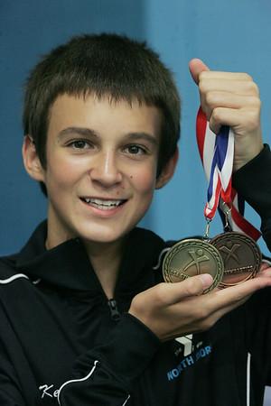 Keegan Richardson and Alex Rouillard with their recent gymnastics medals